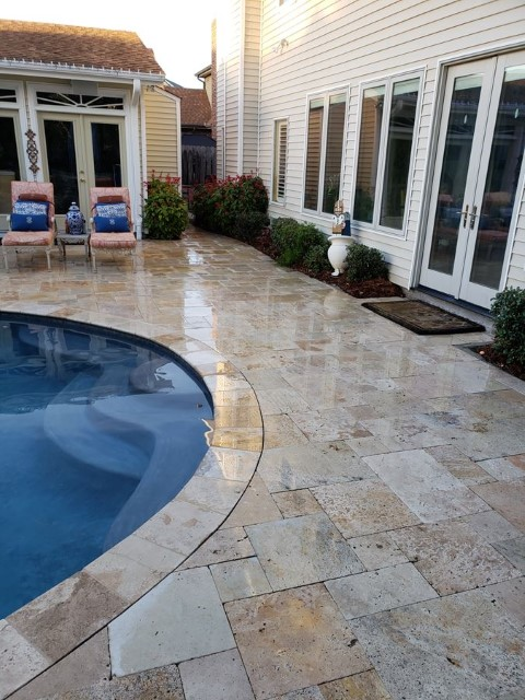 Pool Renovation With Travertine Pavers Installed In